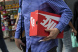 A shopper carries a Nike Inc. shoebox.