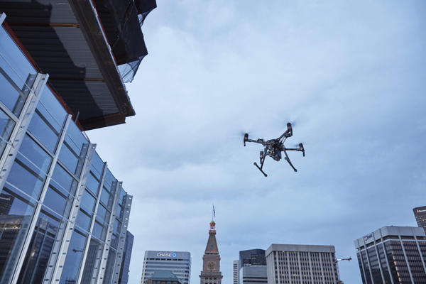 This February 2017 photo provided by DJI Technology Inc. shows a test of a type of drone in downtown Denver, that the New York Police Department can use to reduce risk to officers and bystanders during a response to dangerous situations. The department said Tuesday, Dec. 4, 2018, that potential uses for its 14 drones include search and rescue, hard-to-reach crime scenes, hostage situations and hazardous material incidents. (DJI Technology Inc. via AP)