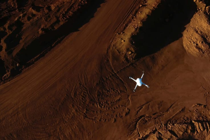 An Airobotics automated drone flies over a mine site. Drones over 250 grams will now face tougher enforcement.
