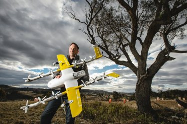 Wing chief executive James Ryan Burgess, pictured above, with one of the household delivery drones