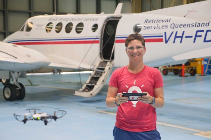 Woman flies drone in front of plane.