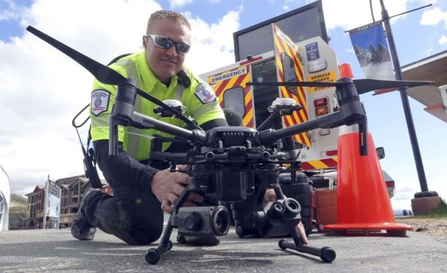 Travis White, Utah Department of Transportation, Highway Incident Management Team, holds a drone at a department demonstrtion Monday in Park City, Utah. Drones are hovering near avalanches in Utah to watch roaring snow. In North Carolina, they're searching for nests of endangered birds. In Kansas, they soon could be identifying sick cows through heat signatures. Public transportation agencies are using drones in nearly every state, according to a new survey released Monday by the American Association of State Highway and Transportation Officials. (AP)