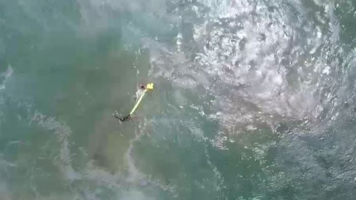 Drone drops rescue pod to distressed teens