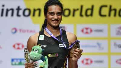 PV Sindhu won the BWF World Championships title by defeating Japan's Nozomi Okuhara in straight games by 21-7, 21-7. (Photo: AFP)