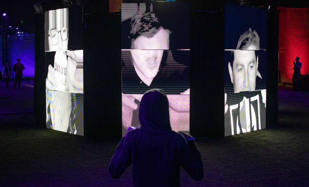 "Luke Yeager, 15, of Las Vegas, views the ""I Am Therefore I Am"" art installation at In ..."